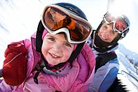 Young girl and grandmother on chair lift