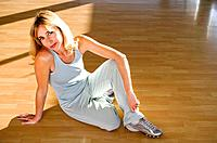 Mature woman stretching in a gym