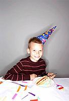 Boy 8_10 with slice of birthday cake