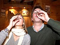 Couple having shots in restaurant