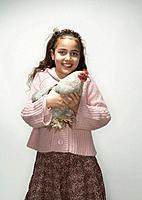 Girl holding hen