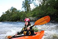 Woman kayaking in river