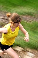 Woman running in countryside
