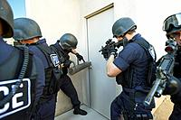 Police officers breaking down doors