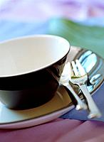 Teacup, fork and knife