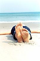 One person lying on the beach (thumbnail)