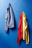 Jumpers on blue color wall