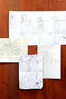 Fashion design sketches on wall