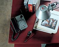 Books and telephone on desk