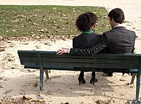 Couple sitting outdoors on bench