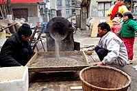 Roasting the sunflower seeds in a small street market in Nanjing,China