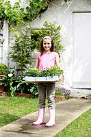Girl holding flower pots