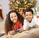 Mixed Race siblings playing video games