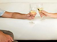 Multi_ethnic couple toasting with wine