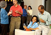 Multi_ethnic friends at party