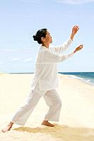 Asian woman practicing tai chi (thumbnail)