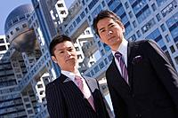 Asian businessmen in front of modern building