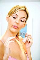 Woman blowing her polished nails