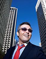 Hispanic businessman wearing sunglasses