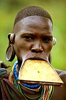 Portrait of a Surma woman wearing a wooden disc plate in her lower lip, Ethiopia