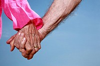 Closeup of senior couple holding hands (thumbnail)