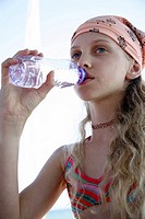 Girl drinking water from a bottle (thumbnail)