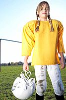 Girl dressed in football uniform