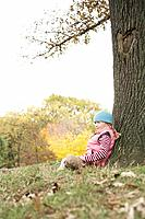 Girl sitting under a tree