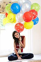 Woman with birthday balloons