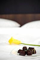Chocolates on bed