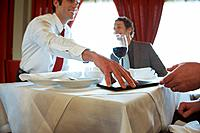 Businessman reaching for the bill