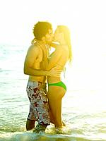 Couple kissing in surf