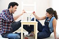 Couple painting chair