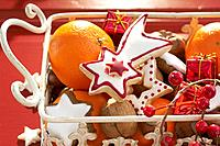 Festive Christmas cookies, nuts and oranges in a basket