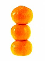 Three stacked Satsuma fruit