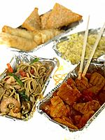 Four containers of Chinese Takeaway with chopsticks