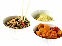 Three bowls of Chinese Takeaway with chopsticks