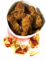 Bucket of Fried Chicken and French fried Chips in take out packaging