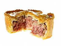 One small Pork Pie with a slice cut out