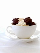 Chocolate_dipped nut meringues in a cup