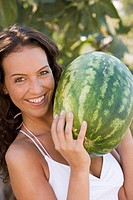 Woman holding a large watermelon