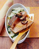 Fried salmon with kohlrabi and shiitake mushrooms