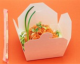 Carrot and ginger salad in a takeaway box