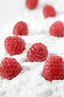 Raspberries on icing sugar