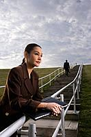 Businesswoman standing on steps