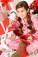 Girl opening up Christmas gifts
