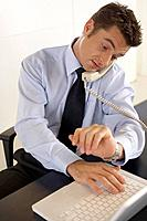 Businessman on laptop and telephone