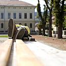 Teenage boy lying on bench