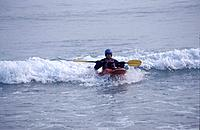 Kayaker Wave Surfing in Pagashak Bay Kodiak Island