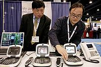 Florida, Miami Beach, Convention Center, Internet Telephony Conference and Expo, telephone, technology, exhibitors, booths, buyer, seller, Asian, man,...